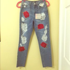 Missguided.com rose printed distressed riot jeans.